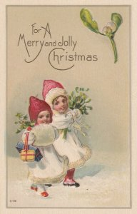 CHRISTMAS , 1900-10s ; 2 kids with Mistletoe & Holly