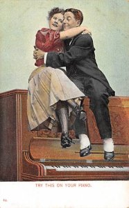 Man and Woman sitting on a Piano  Postcard Unused