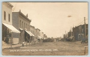 Wellsburg IA~Main Street North~Men & Boy at Savings Bank~Wagons & Cars~1911 RPPC