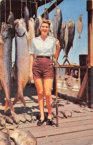 Fishing Postcard Woman with a Pole and Fish Hanging Behind Her PU Unknown