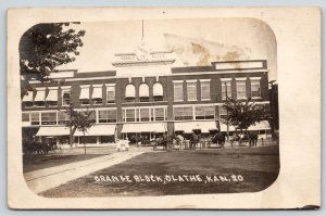 Olathe Kansas~Grange Block Store~Meat~Grocery~Clothes~Hats Caps~Wagons~1911 RPPC