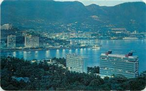 Twilight settles over the bay of Acapulco Mexico postcard