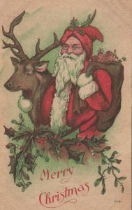 CHRISTMAS; PU-1910;  Santa Claus with arm around a reindeer