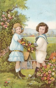 Two little girls carrying a basket with flowers Nice old vintage German postca
