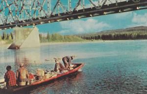 Loaded boat ubder iard Bridge , Mile 642 Alaska Hiway, Yukon , Canada , 40-60s