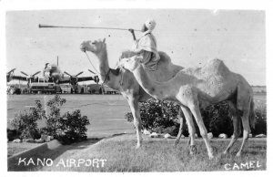 Kano Nigeria Airport Man on Camel blowing Horn Real Photo Postcard AA45125