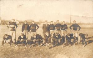 Real Photo Post Card~14 Players~Football Team~Coach~Hike Ball~Goal Posts~c1912