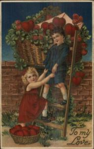 Valentine - Sweet Children Basket of Huge Hearts Over Wall c1910 Postcard