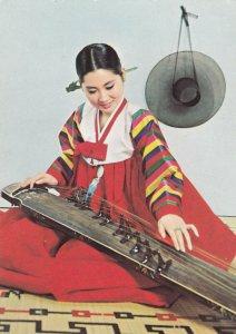 KOREA , 1950-70s ; Korean Air Lines ; Woman plays Kayakum