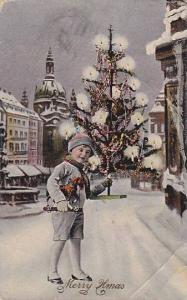 Merry Xmas, Boy holding small Christmas tree and toy pony, PU-1924