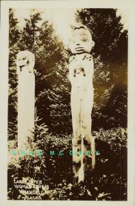 1910 Wrangell Alaska RPPC: Otter & Woman Totem Poles