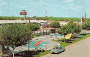 Laredo Texas~Sands Motor Hotel~Swimming Pools~Playground~60s Car~People~Postcard