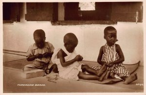 Ghana Gold Coast Natives kids threading beads real photo Postcard