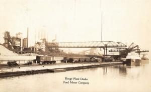 Dearborn MI~Ford Motor Co~Rouge Plant Docks~Cars~Crane Loads Freighter~1920 RPPC