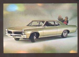 1967 PONTIAC TEMPEST CAR DEALER ADVERTISING POSTCARD '66 GOAT