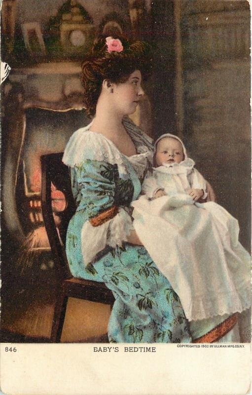 Baby's Bedtime~Mother Cradles Long Gowned Baby~Lit Fireplace~Mantel Clock~1902
