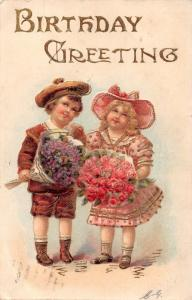BIRTHDAY GREETINGS~BOY & GIRL IN VICTORIAN CLOTHING HOLD FLOWERS~ARTIST POSTCARD