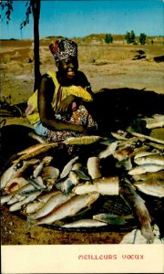 IMN00917 africa types folklore woman cooking fish