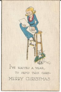Comical Card Crazy Cat Lady sitting on stool reading letter cat w/ X-Mas Wreath