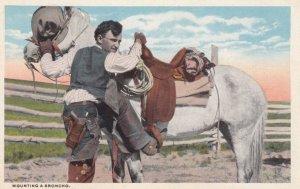 Cowboy Mounting a Broncho, 1910-20s
