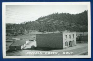Buffalo Creek old autos buildings depot? real photo postcard RPPC