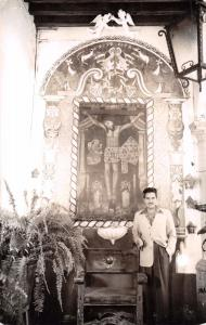 MEXICO MAN STANDING IN FRONT OF DRAWING OF JESUS REAL PHOTO POSTCARD 1950s