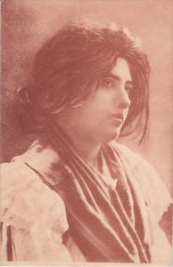 Profile of woman wearing a scarf, 00-10s