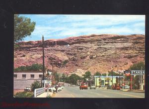 MOAB UTAH DOWNTOWN STREET SCENE 1950's CARS VINTAGE POSTCARD TRUCKS STORES