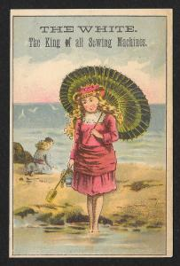 VICTORIAN TRADE CARD White Sewing Co Girl in Dress with Parasol at Beach