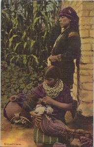 FAMILY GROUP ...View of native man watching over a young woman nursing a child