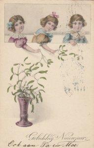NEW YEAR, 1915; Gelukkig Nieuwjaar, Girls plucking leaves from flowerpot
