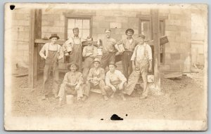 RPPC Group of Men (Masons) At Newly Built Block House in Bibs~Buckets c1916 PC