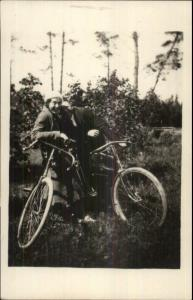 Man & Woman Pose w/ Their Bicycles c1920s Real Photo Postcard