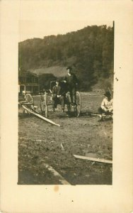 Postcard RPPC Men At Wagon