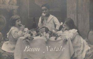 RP: BUON NATALE, 1900-10s; Children enjoying Christmas bread