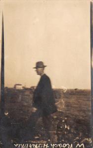 Hooker Oklahoma~W Roach~Tall Man Walks in Farm Field~House Behind~c1912 RPPC