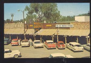 WALL SOUTH DAKOTA DRUG STORE ADVERTISING POSTCARD VOLKSWAGEN 1960's CARS