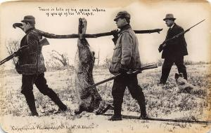 Hunters Carry Rifles and Exaggerated Rabbit on a Pole~Real Photo Postcard c1910