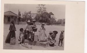 RP: MOLLENDO, Peru, 1910s; Kids getting water from Public Water hydrant in plaza