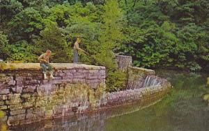 Fishing on the old mill dam at Blanchard Sprinngs, Arkansas, 40-60s
