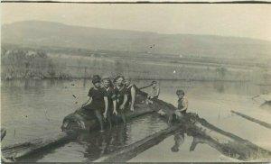C-1910 Children Playing lumber Log Pond RPPC Photo Postcard 21-7132