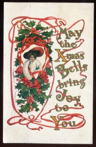 h2298 - CHRISTMAS Postcard 1911 Embossed Gilded Tree Bells Woman