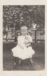 RP: BELLOWS FALLS , Vermont , 1912 ; Child holding a doll