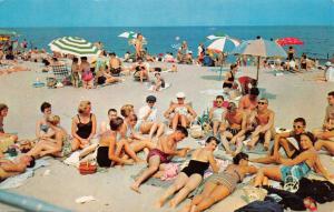 CLINTON NORTH CAROLINA SUN TANNING ON THE BEACH POSTCARD 1960s