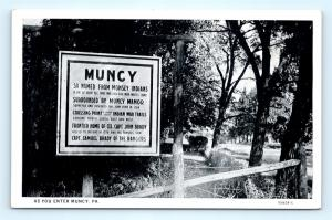 Postcard PA Muncy Sign As You Enter Muncy Historical Info I14