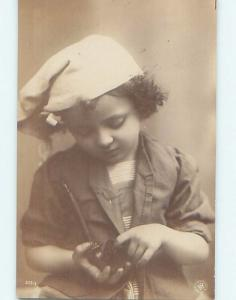 1907 rppc YOUNG GIRL PUTTING YOUR FINGER INTO TOBACCO PIPE HM1036