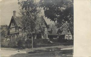 c1910 RPPC Postcard; Street View Tudor Style House, Eau Claire WI Posted