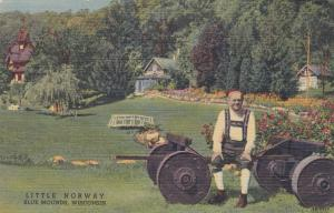 BLUE MOUNDS, Wisconsin, 30-40s ; Little Norway, Man sitting on farm equipment