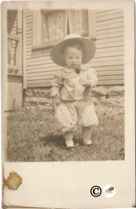 Real Photograph Postcard Baby Boy or Girl dressed in Pants and Coat