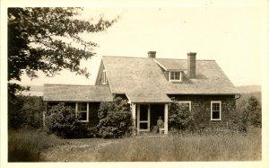 NH - Gilford. Lockes Hill Rd Cottage, Lake Winnipesaukee in background  *RPPC